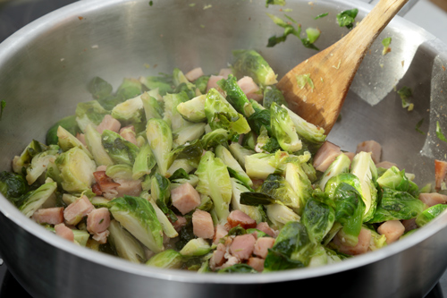 fry your brussel sprouts in a frypan with bacon and onion